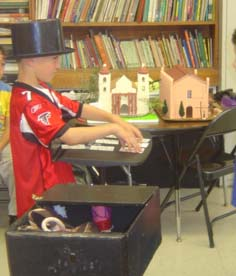Kid learning magic trikcs Brandon Scott's Kids Magic School